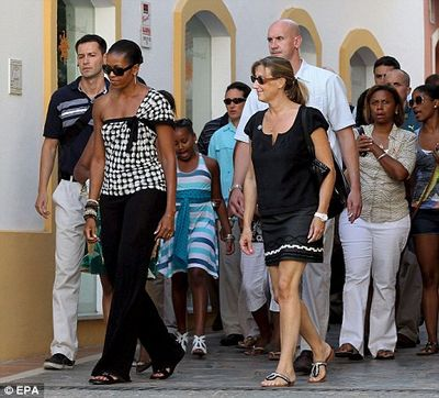 Me and my heavies Michelle Obama goes walkabout in Marbella after 'racist' Spaniards gaff 1