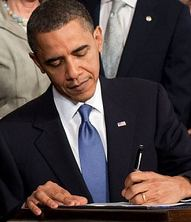 Obama_signs_health_care-crop4
